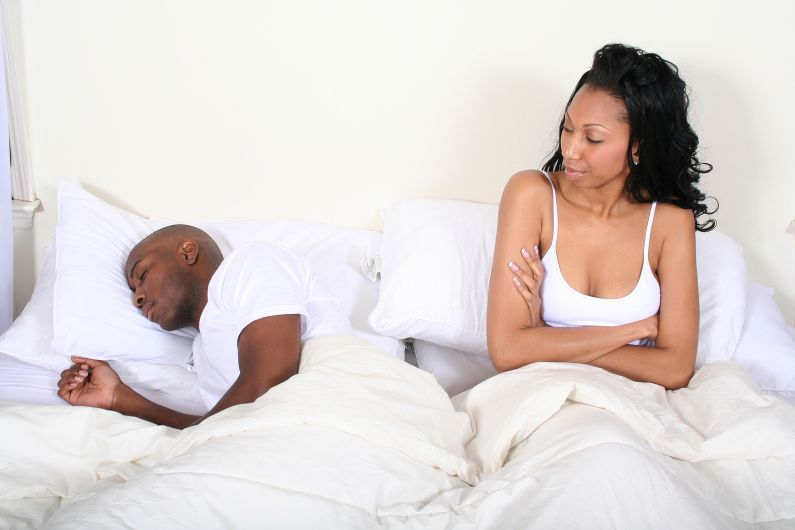 Unhappy-Woman-Sleeping-Man-in-Bed-Couple-The-Trent-795x530