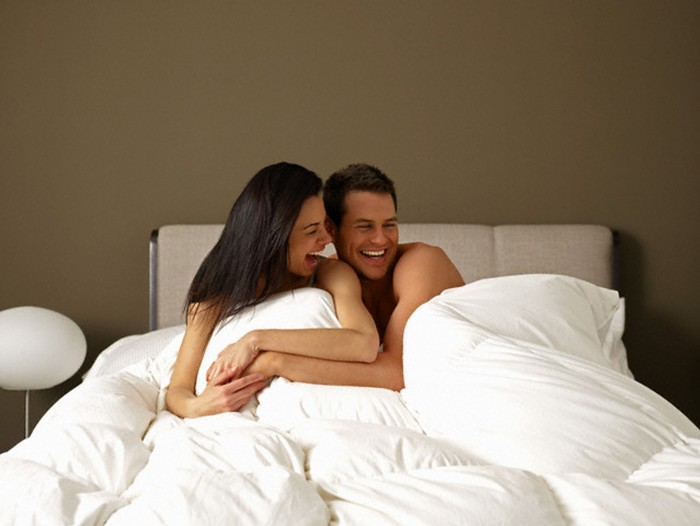 love-sex-relationship-Lauging-Couple-In-Bed-TheinfoNG-700x526