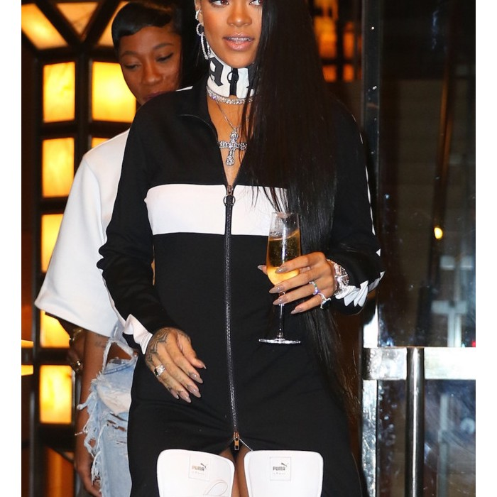 6.September.2016 - New York – USA **STRICTLY AVAILABLE FOR UK AND GERMANY USE ONLY** New York, NY - Rihanna totes a glass of champagne while heading out to Foot Locker for the launch of her new Puma line this evening in New York BYLINE MUST READ : AKM-GSI-XPOSURE ***UK CLIENTS - PICTURES CONTAINING CHILDREN PLEASE PIXELATE FACE PRIOR TO PUBLICATION *** *UK CLIENTS MUST CALL PRIOR TO TV OR ONLINE USAGE PLEASE TELEPHONE 0208 344 2007*