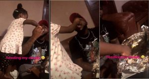 Davido's first daughter, Imade pictured feeding her dad