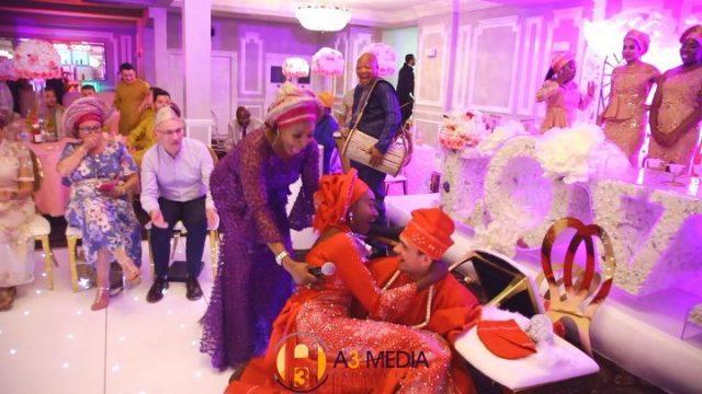 Groom carrying his bride