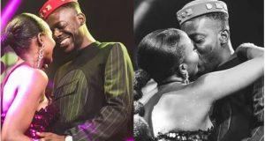 photo of Adekunle Gold and Simi kissing