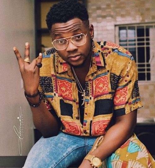 Kizz Daniel shows the hand sign
