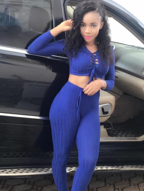 Chisom Okpala next to a car