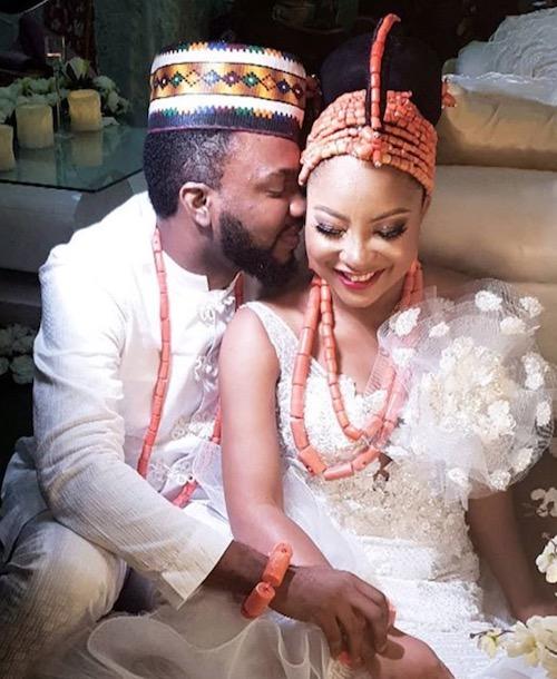Ibrahim Suleiman kisses Linda Ejiofor on their wedding day