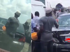 Watch the trending video of a guy who washes cars in Lagos Traffic